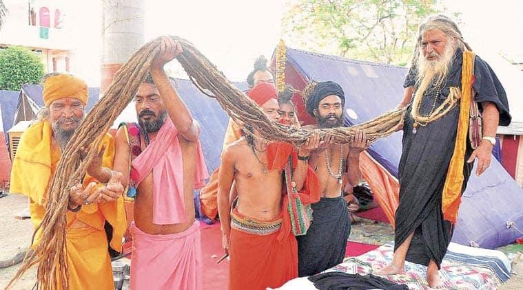 A sadhu flaunts 16-ft-long locks at the Kumbh Thursday. PTI