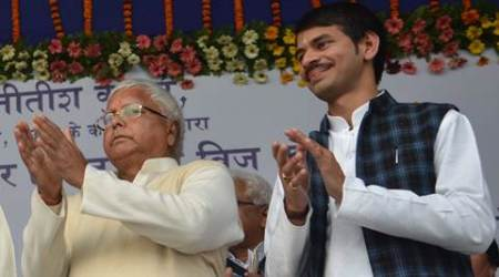 Lalu Prasad with his son Tej pratap during a function in Bihar. Express archive photo. 31.01.2016. *** Local Caption *** Lalu Prasad with his son Tej pratap during a function in Bihar. Express archive photo. 31.01.2016.