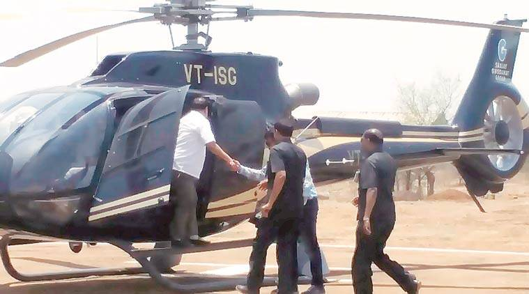 Eknath Khadse lands at the helipad in Belkund village on Friday. Express photo