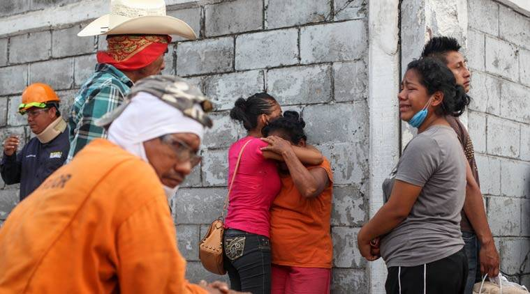 Relatives of missing workers gather outside the Pajaritos petrochemical complex in Coatzacoalcos, Mexico. (Source: AP)