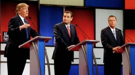 FILE- In this March 3, 2016 file photo, Republican presidential candidates, businessman Donald Trump, Sen. Ted Cruz, R-Texas, and Ohio Gov. John Kasich appear during a Republican presidential primary debate at the Fox Theatre in Detroit. Michigan Republicans meet Saturday, April 9, in Lansing for their annual convention with one of the main agenda items the choosing of delegates to the party's presidential convention in July in Cleveland. (AP Photo/Paul Sancya)