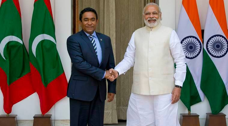 Prime Minister Narendra Modi with Maldives' President Yameen Abdul Gayoom before a delegation-level meeting in New Delhi. (AP Photo/Manish Swarup)