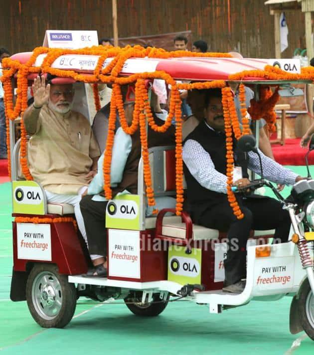 Narendra Modi, Narendra Modi e-rickshaw, Modi ride e-rickshaw, modi e-rickshaw ride, Stand up India, Stand India launch Pics, Narendra Modi pics, Modi pics, modi e-rickshaw pics, India news, Arun Jaitley, Jayant Sinha, Ram naik