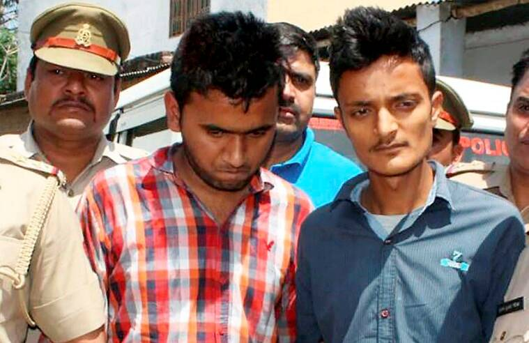 RPT...Moradabad : Accused Janu and Rehan produced in court in connection with the murder of  NIA Deputy SP Mohammad Tanzil  in Moradabad on Tuesday. PTI Photo (PTI4_12_2016_000320B)