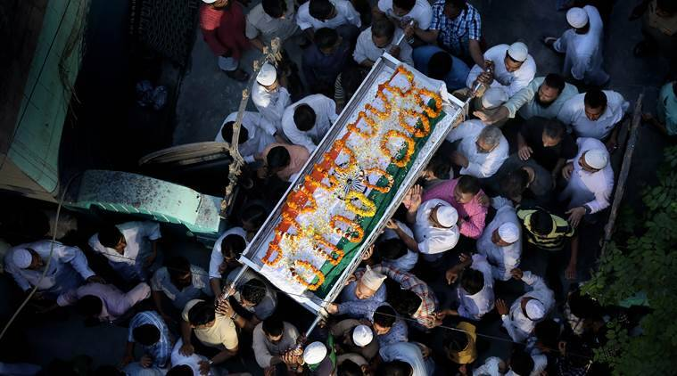 Family members and relatives carrying the body of National Investigation Agency (NIA) officer Mohammad Tanzil, wrapped in the Indian national flag, who was shot dead by two unidentified attackers near his hometown Bijnor, as they take out for the burrial from his Shaheen bagh home in Delhi on April 3rd 2016. (Source: Express photo by Ravi Kanojia)