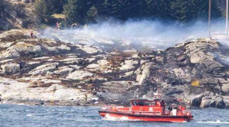 Norway helicopter crash: At least 11 bodies found, 2 people still missing, says rescue official