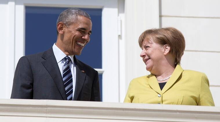 President Barack Obama and GermanChancellor Angela Merkel stand together on a balcony at Schloss Herrenhausen in Hannover, Germany, Sunday, April 24, 2016. Obama has arrived in Germany to mount a two-day push to sell his trans-Atlantic trade pact. (AP Photo/Carolyn Kaster)