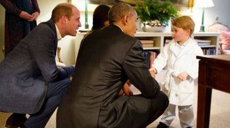 Two-year-old Prince George skips nap time, meets Obamas in his pyjamas