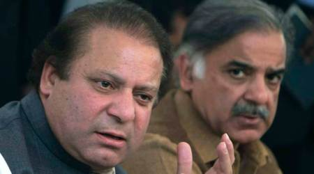 FILE -  In this Feb. 17, 2008 file photo, Pakistan's Prime Minister Nawaz Sharif, left, and his brother Shahbaz Sharif address a news conference in Lahore, Pakistan. Sharif has announced that he will set up an independent judicial commission to probe whether his family is involved in illegal overseas investments after reports based on documents leaked from a Panama-based law firm indicated his sons owned several offshore companies. (AP Photo/KM Chaudary,File)