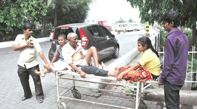 Three patients being carried on a stretcher at the PCMC-run YCM hospital which is under scanner over a botched-up operation in January. Express photo