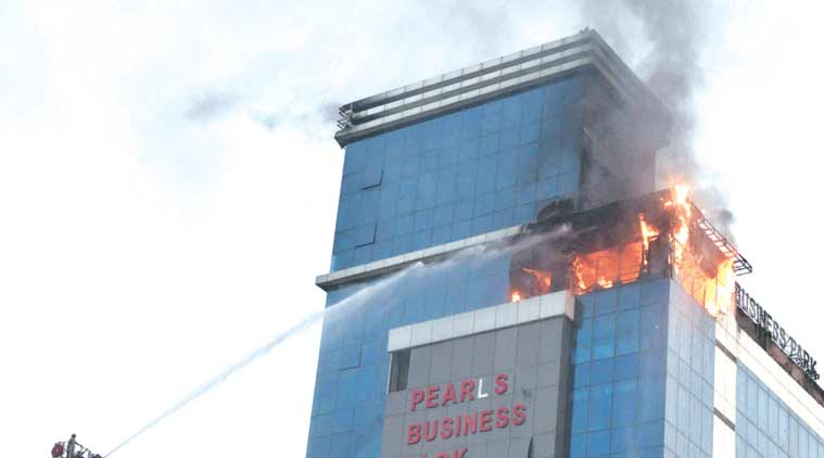 Fire at Pearls Business Park building Sunday. (Source: PTI)