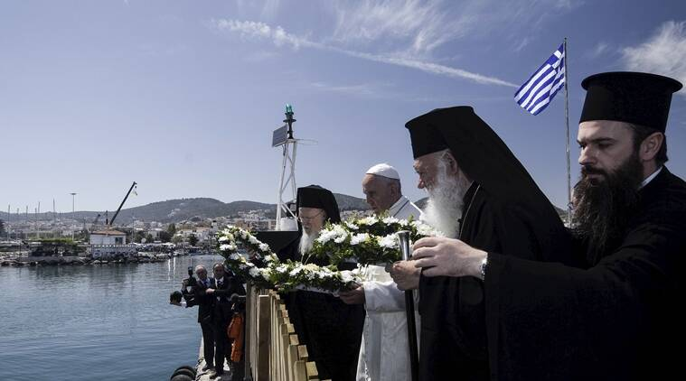 Pope Francis, Archbishop Ieronimos (front) and Greek Orthodox Ecumenical Patriarch Bartolomew I (back) prepare to throw flower wreaths in the sea in memoriam of the refugees that lost their lives in their effort to reach Europe, during the Pope's visit on the Greek Island of Lesbos aiming at supporting refugees and drawing attention to the front line of Europe's migration crisis in Lesbos in this handout photo released by the Greek Prime Minister's press office, April 16, 2016. REUTERS/Andrea Bonetti/Greek PM Press Office/Handout via Reuters ATTENTION EDITORS - THIS PICTURE WAS PROVIDED BY A THIRD PARTY. REUTERS IS UNABLE TO INDEPENDENTLY VERIFY THE AUTHENTICITY, CONTENT, LOCATION OR DATE OF THIS IMAGE. EDITORIAL USE ONLY. NOT FOR SALE FOR MARKETING OR ADVERTISING CAMPAIGNS. NO RESALES. NO ARCHIVE. THIS PICTURE IS DISTRIBUTED EXACTLY AS RECEIVED BY REUTERS, AS A SERVICE TO CLIENTS