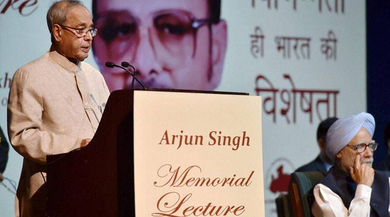 New Delhi: President Pranab Mukherjee delivering the 1st Arjun Singh Memorial Lecture organized by the Arjun Singh Sadbhavna Foundation in New Delhi on Saturday. Former Prime Minister Manmohan Singh is also seen. PTI Photo by Vijay Verma (PTI4_9_2016_000147B)