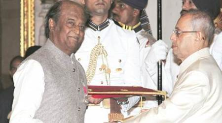 President Pranab Mukherjee presents Padma Bhushan to Bollywood  actor Rajinikanth at Padma Awards 2016 function at Rashtrapati Bhavan in New Delhi on Tuesday. Express photo by Renuka Puri