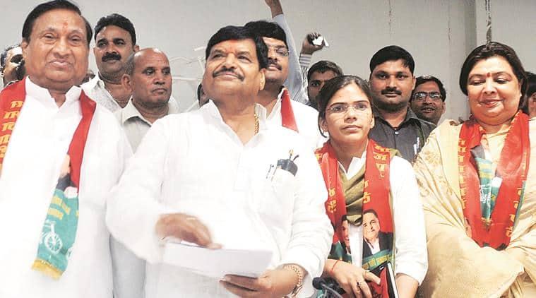 AUSU president Richa Singh and BJP vice-president for Braj region Kundanika Sharma with SP's in-charge for 2017 polls Shivpal Yadav, in Lucknow on Saturday. Express photo by Vishal Srivastav