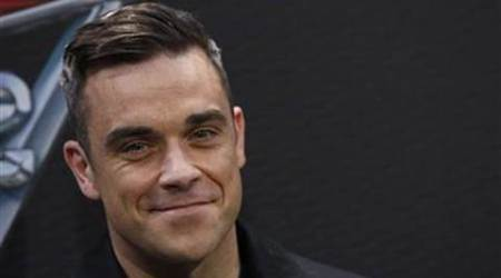 Robbie Williams rejoining Take That, writing their new material?