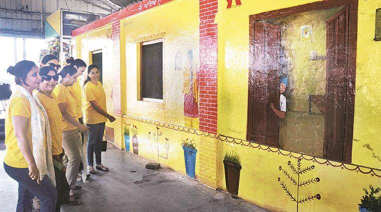 Women of Ludhiana care group at painted wall of waiting room at Railway station in Ludhiana.express Photo by Gurmeet Singh