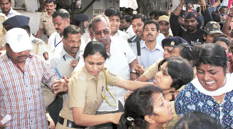 Trupti Desai, leader of the Bhumata Brigade, being dragged away by police during an attempt to offer prayers at the Shani Shingnapur temple. (Express Photo)