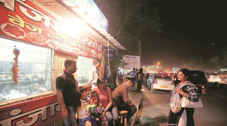 People spend their time sipping tea at dhabas or watching movies in their car. Express Photo by Amit Mehra
