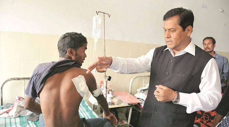 Dibrugarh :Union minister of Sports and BJP Chief Ministerial candidate for Assam Sarbananda Sonowal visiting the injured victims at the Assam Medical College & Hospital in Dibrugarh on Tuesday. PTI Photo