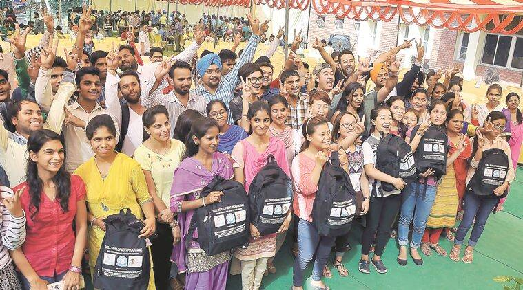 Underprivileged students with the learners' toolkit being distributed during a skill development programme at Rajiv Gandhi National Institute of Youth Development, Regional Centre, in Sector 12, Chandigarh on Monday. Sahil Walia