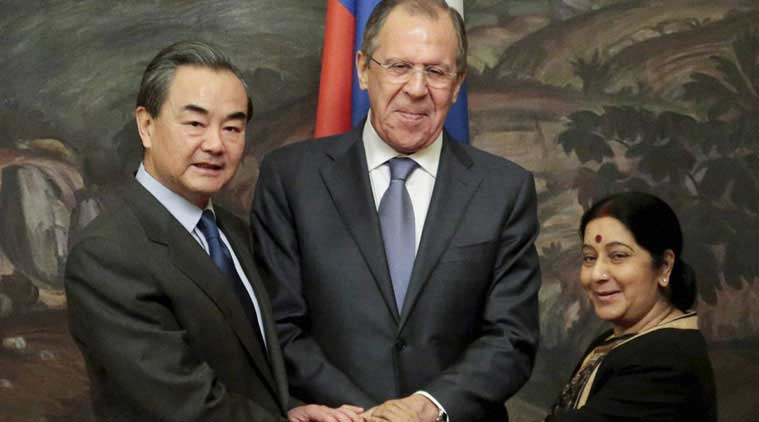 From left: Chinese Foreign Minister Wang Yi, Russia Foreign Minister Sergey Lavrov and Indian Foreign Minister Sushma Swaraj shake hands after a meeting in Moscow, Russia, Monday, April 18, 2016. (Source: AP)