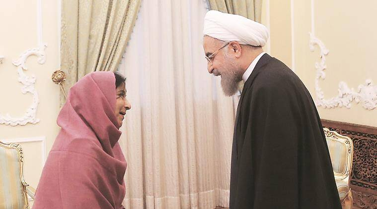 Iranian President Hassan Rouhani, right, welcomes Indian Foreign Minister Sushma Swaraj at the start of their meeting in Tehran, Iran, Sunday, April 17, 2016. (AP Photo/Vahid Salemi)