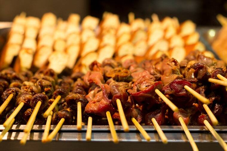 A platter of beef and lamb snacks.