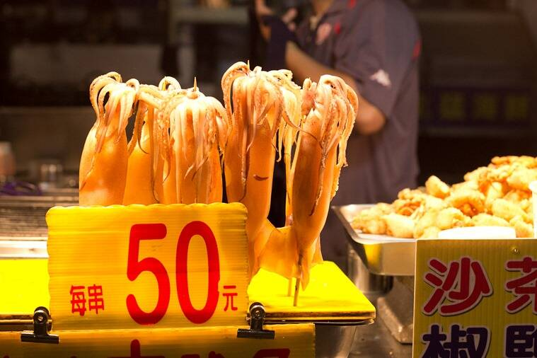 A collection of squid on a stick.