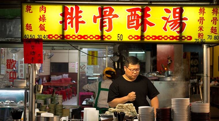 Neon signs light up the street food carts.