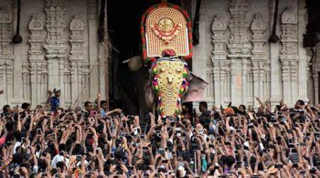 Thrissur: 'Thechikottukavu Ramachandran' to open the door of the southern gopuram of the Vadakkumnathan temple to formally announce the beginning of the Thrissur Pooram on Saturday.   PTI Photo (PTI4_16_2016_000215B)