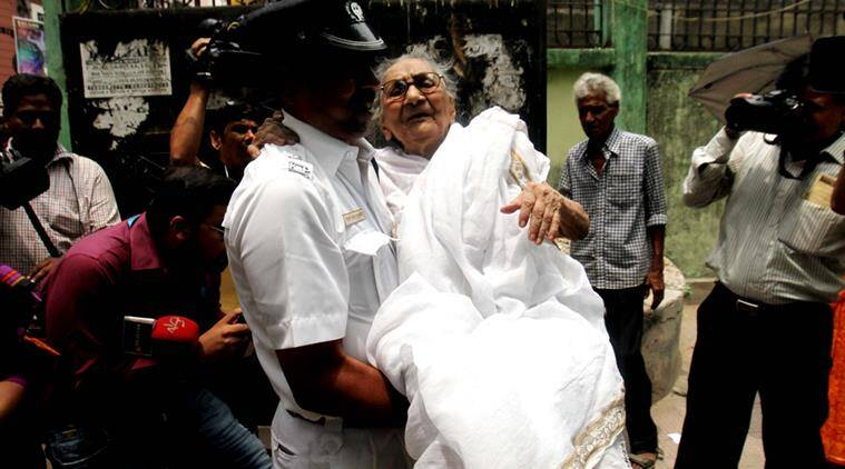Malina Bhattacherjee, a 100 years old voter taken to polling station during 5th phase vote in Bengal on Saturday at Chetla in South Kolkata. Express photo by Subham Dutta. 30.04.16