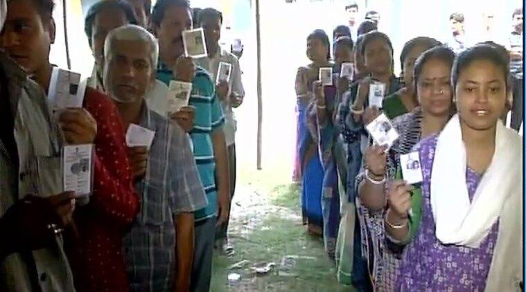 Voters line up outside a polling booth in Malda. ANI photo
