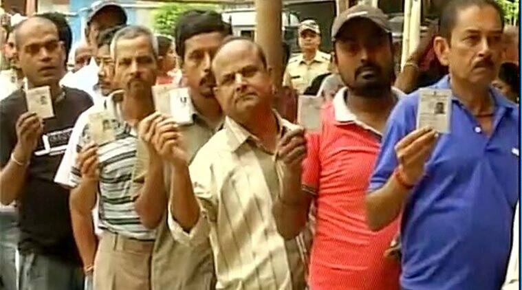 People outside a polling booth in west bengal early in the morning. ANI photo