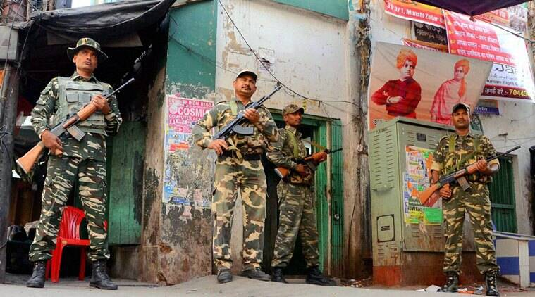Central Force jawans keep strict vigil in front of a polling station on the eve of 4th phase of West Bengal Assembly election,in Howrah district of West Bengal on Sunday. PTI Photo(PTI4_24_2016_000218A)