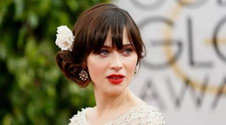 Motherhood made Zooey Deschanel 'feel like an adult'
