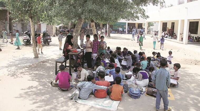 With high strength of students and less rooms classes goes under tree and varandas at Govt. Primary school at Giaspura in Ludhiana.Express Photo by Gurmeet Singh