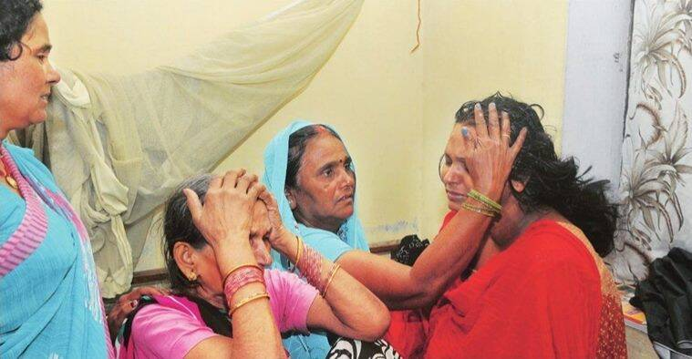 Relatives console Asha,w ife of murdered journalist Rajdev Rajan. Express Photo/Prashant Ravi