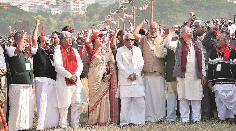 Kolkata: CPI(M) leader V S Achuthanandan, CPI(M) General Secy Sitaram Yechury, Former West Bengal Chief Minister Buddhadeb Bhattacharjee, Left Front Chairman Biman Bose Former Secretary Prakash Karat, State Opposition Leader Surya Kanta Mishra and others in an open rally during their Kolkata Plenum in Kolkata on Sunday. PTI Photo by Ashok Bhaumik (PTI12_27_2015_000078B)