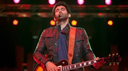 Aditya Roy Kapur gets a hand wrapped guitar from his fan