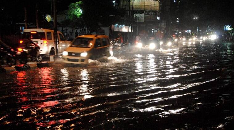 Guwahati: Vehicles move through water logged GNB road of Guwahati on Tuesday after heavy rainfall. PTI Photo (PTI5_17_2016_000198A)