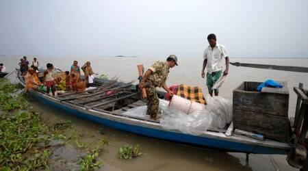 A BSF jawan checking a boat on the open border with Bangladesh on the Brahmaputra in Dhubri district in Assam. (Photo: Dasarath Deka)