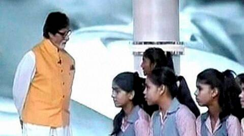 New Delhi: Actor Amitabh Bachchan interacts with a girl in the Beti Bachao Beti Padhao programme at the mega bash organised to highlight the NDA government's achievements in the two years, at India Gate in New Delhi on Saturday. PTI Photo / TV GRAB (Doordarshan)   (PTI5_28_2016_000179B)