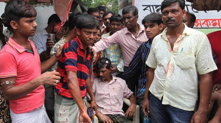 Injured RSP supporters Atiar Sheikh (r) with other at Bhangankhali Village under Basanti Constituency is allegedly beaten by TMC . Express photo by Partha Paul.30.04.16