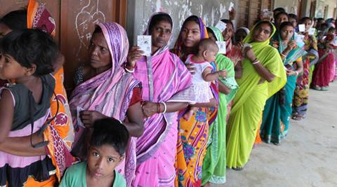 Voters stand outside  sonachura K C A Milan Vidya Mandir  polling booth at Sonachura , Nandigram , East Midnapore. Polling held for 25 constituencies of East Midnapore (16 constituency) and Coachbehar (9 constituency) districts, in the final phase of West Bengal state assembly election on Thursday, May 05, 2016. Express photo by Partha Paul