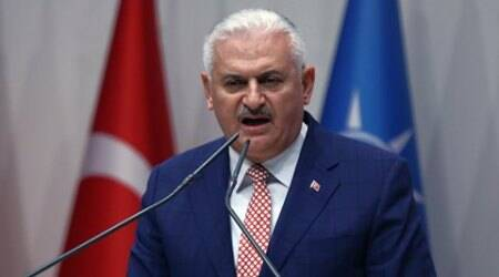 Binali Yildirim, Turkey's current Transportation Minister and founding member of the AKP, Turkey's governing party, speaks during a meeting in Ankara, Turkey, Thursday, May 19, 2016. Yildirim is expected to stand unopposed for the party leadership and automatically become Prime Minister at an extraordinary meeting to be held Sunday in Ankara. The shake up comes after Prime Minister Ahmet Davutoglu stepped down on May 4. (AP Photo)