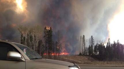 Canada wildfire: Officials evacuating 8,000 people by air