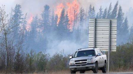 "Canadian officials hope to put ""death grip"" on fire"