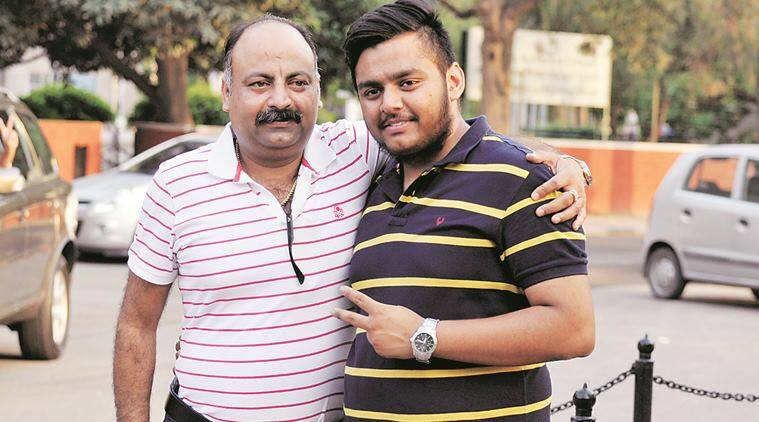 Hanish Aggarwal with his father, secured 98.2% in Non Medical topper of CBSE +2 Board Exam at Leisure Valley in sector 10 Chandigarh on Saturday, May 21 2016. Express Photo by Sahil Walia