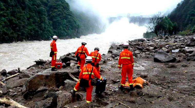 Rescuers search for potential survivors at the site following a landslide in Taining county in southeast China's Fujian province. (Photo: AP)
